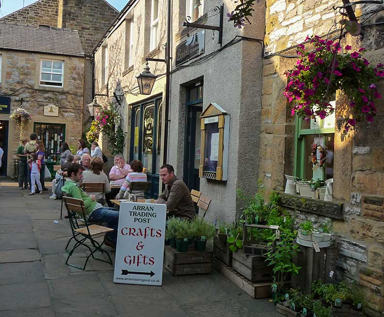 People sitting at outside tables at Bakewell Cafe