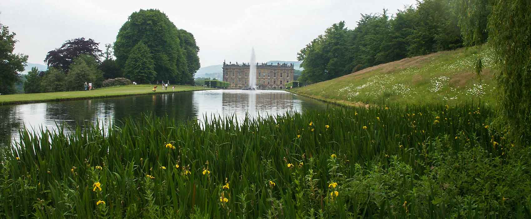 Chatsworth across the lake with daffodils in the foreground