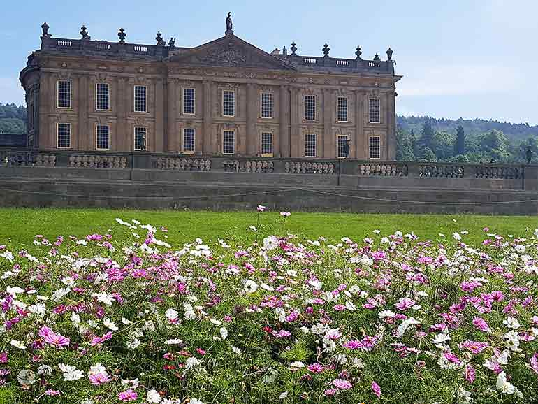 View of Chatsworth house with flowers in the foreground