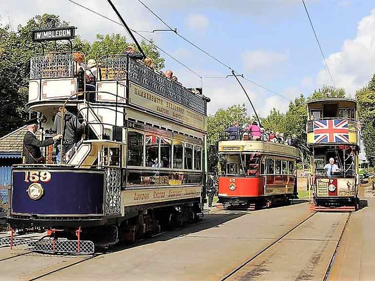 Crich Tramway with passengers and conductor