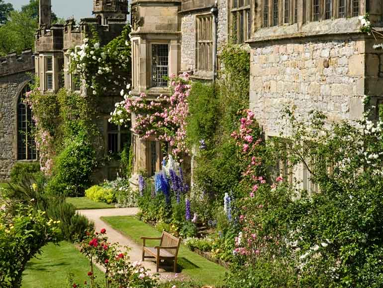 Front of Haddon Hall covered in flowers
