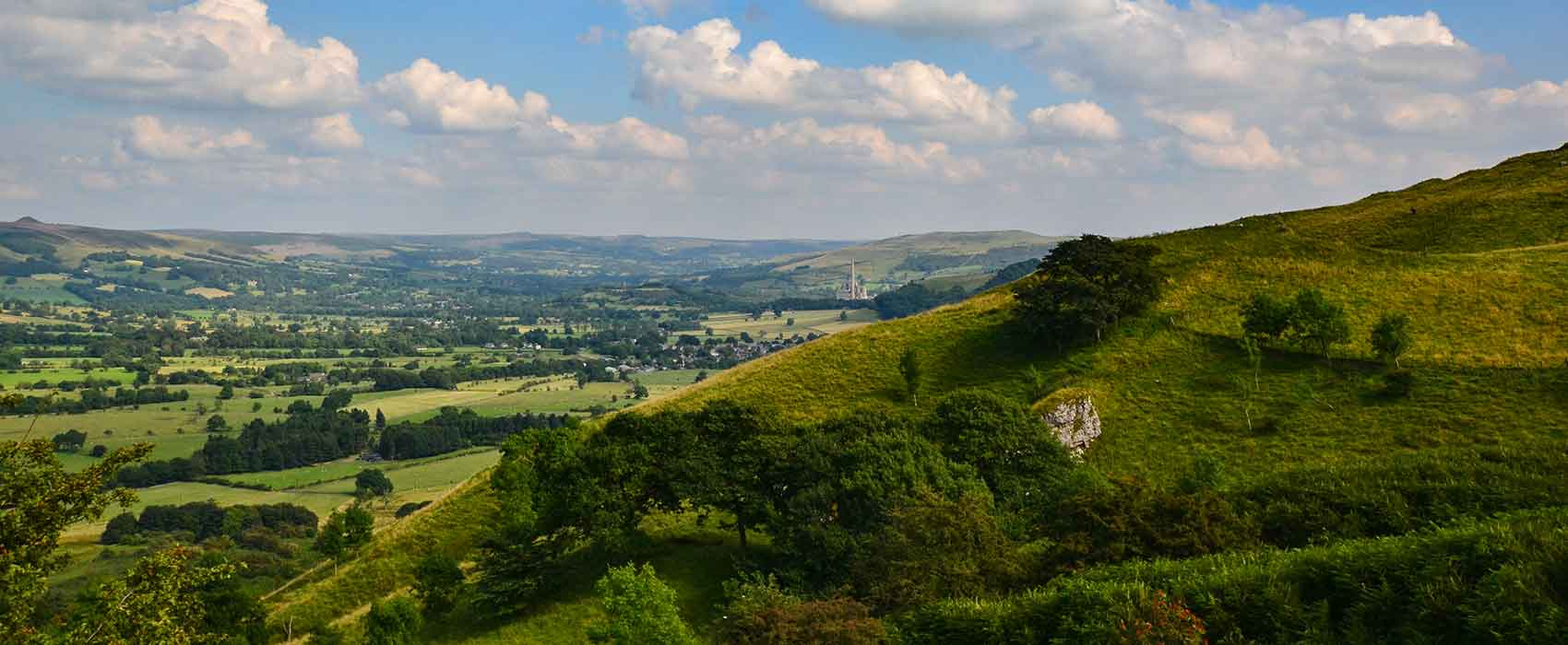 View across the green fields of Hope Valley in Peak District