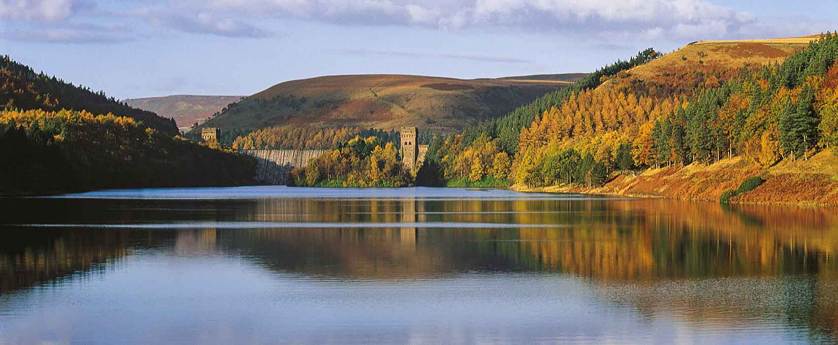 View across reservoir to Howden dam in Peak District