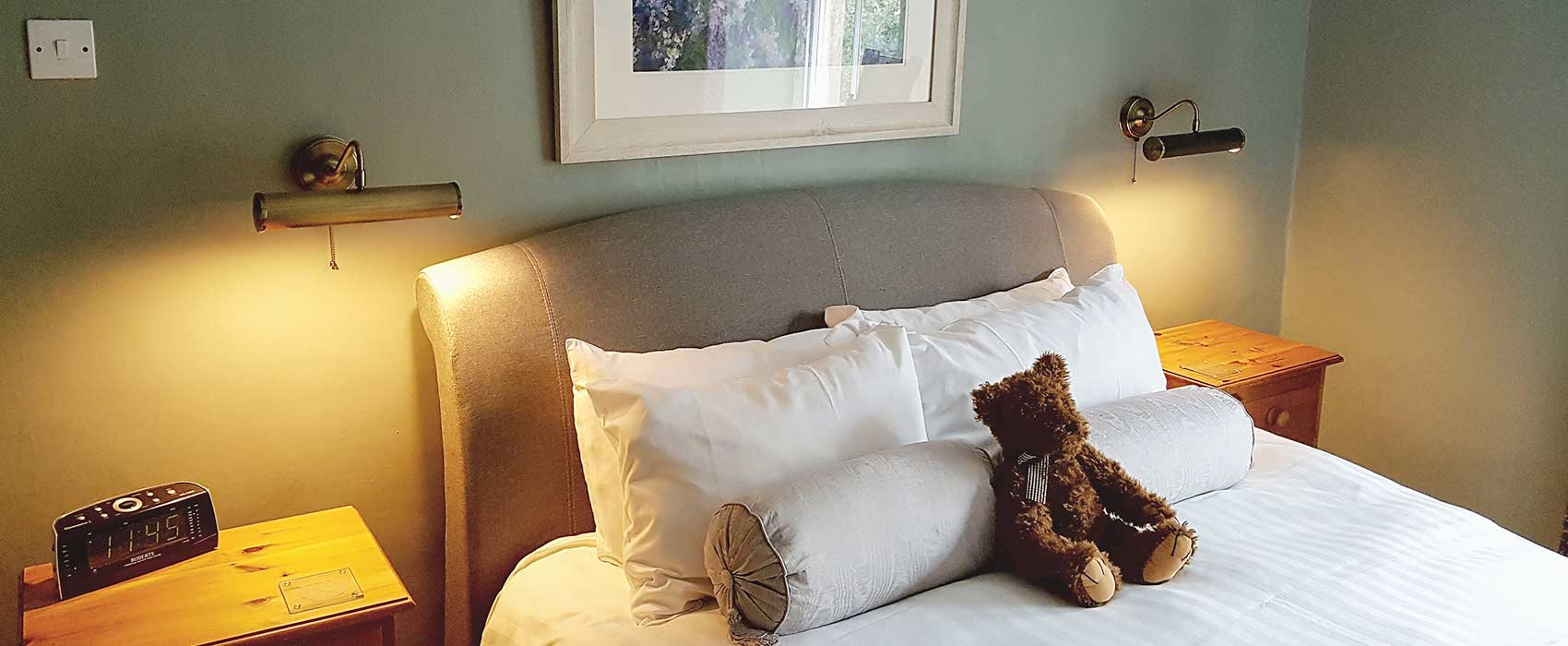 Master bedroom with teddy bear, light with brass lights