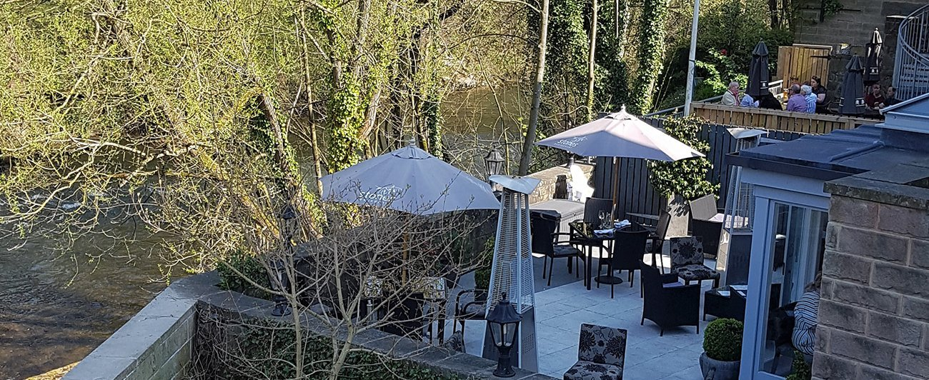 Stones restaurant in Matlock on edge of river Derwent