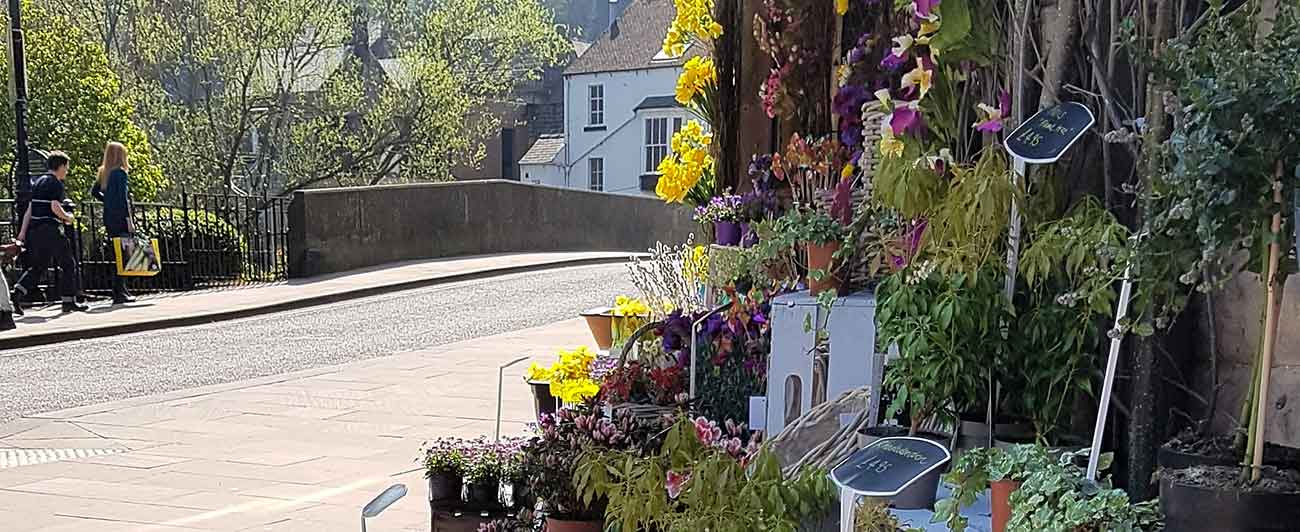 Matlock Derwent Bridge with flower stall