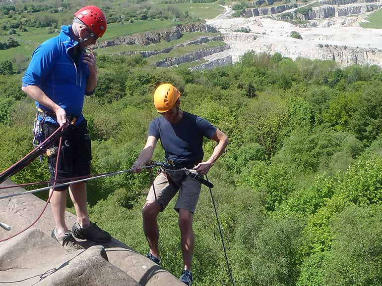 Instructor and man abseiling