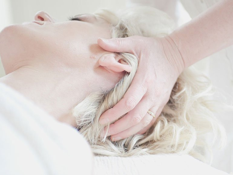 Young woman being given an Indian head massage