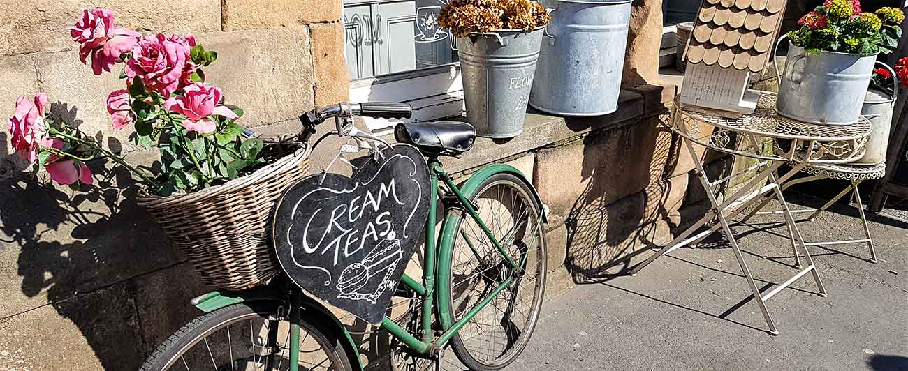 Bike with cream tea sign for cafe