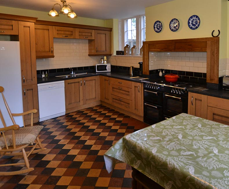 Large kitchen with range cooker and Victorian tiled floor
