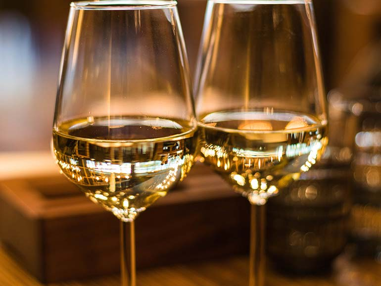 Two glasses of white wine with blurred background