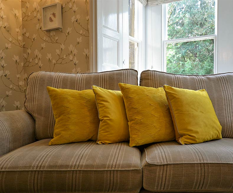 Sitting room sofa with yellow cushions
