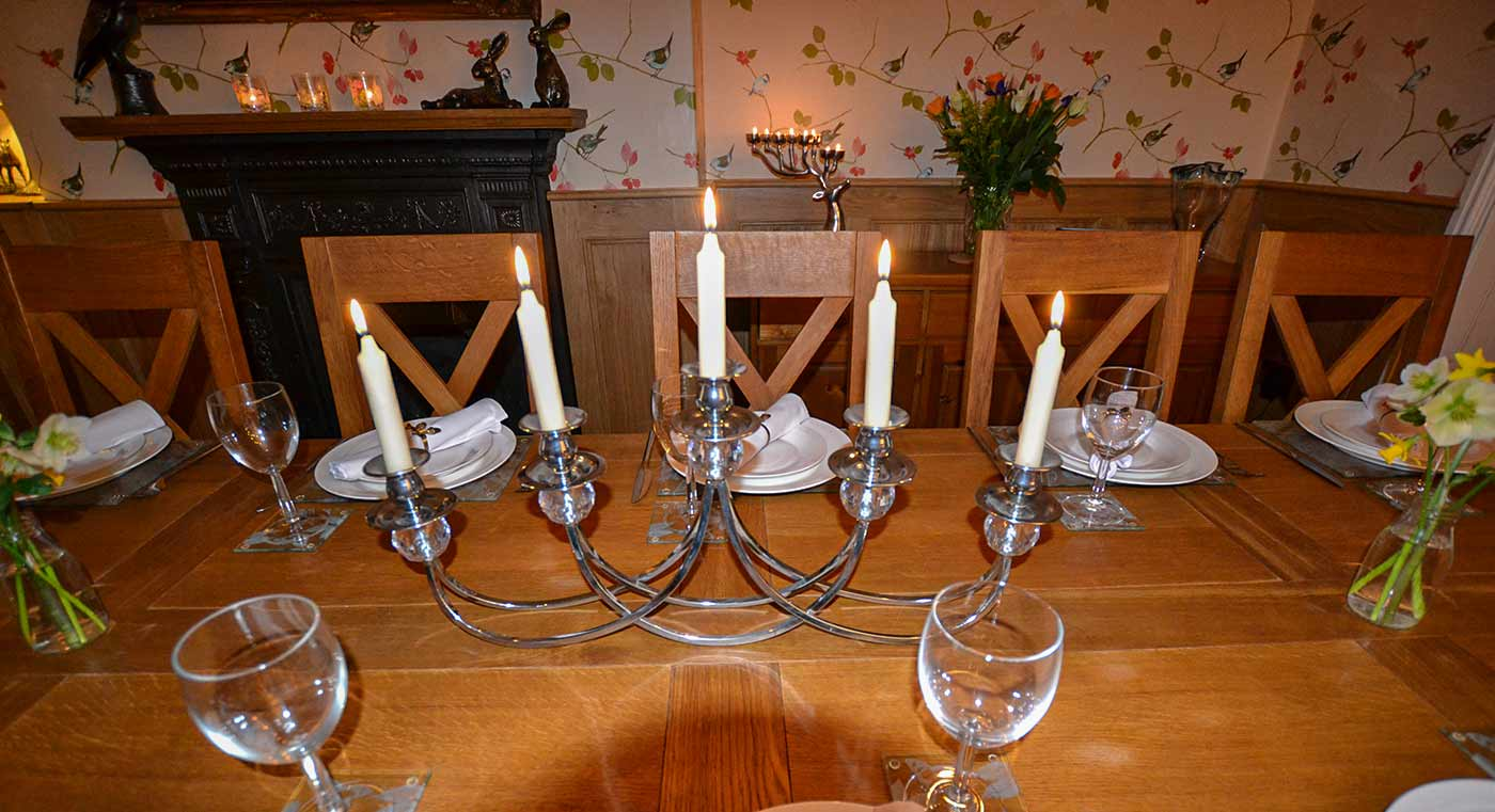 Derwent House dining room lit by candles