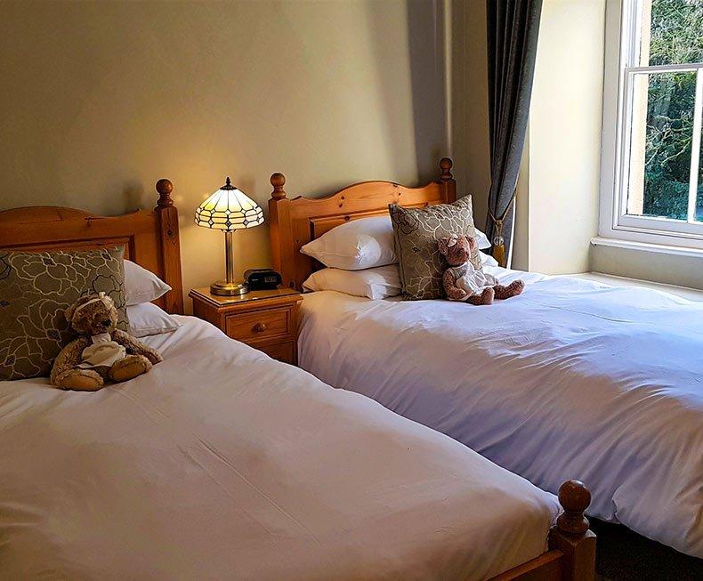 Twin pine beds in green bedroom