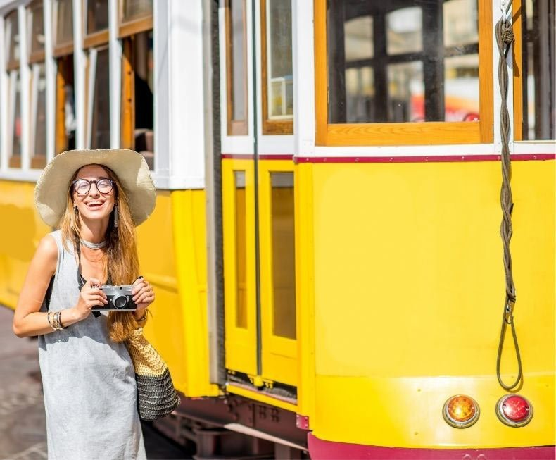 Woman next to tram