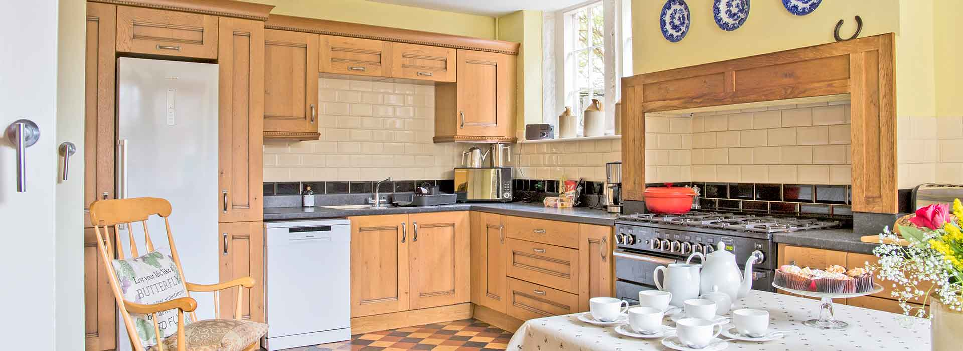 Large kitchen with view of range cooker